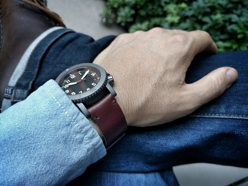 Mahogany leather, minimalist stitch, raw edge, on COURG A-11.