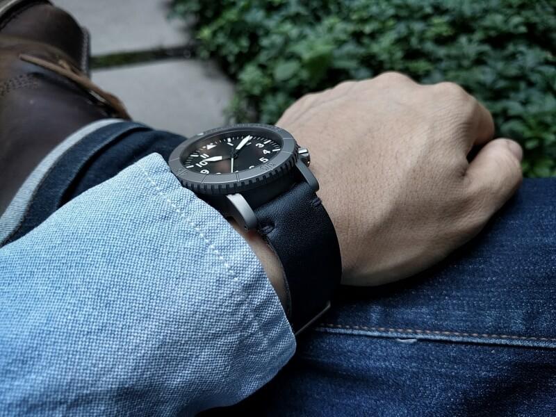 Pitch black leather, minimalist stitch, raw edge, on COURG Type-A.