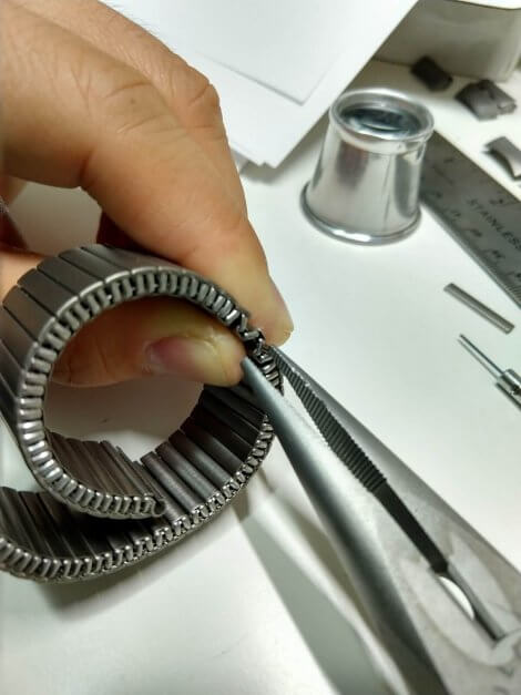 Needle nose pliers to extract the c-clip